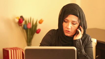 Muslim businesswoman talking on the phone