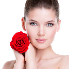 Beautiful young woman with red rose.