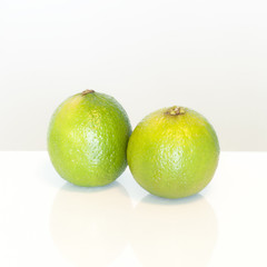 Two fresh green limes