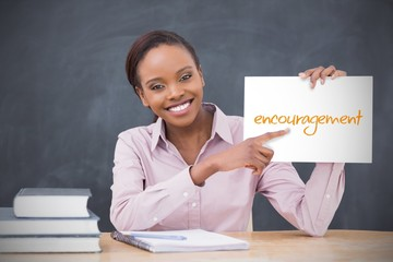 Happy teacher holding page showing encouragement