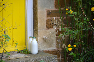 Milk bottles on doorstep