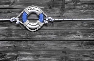 Holz Hintergrund mit Rettungsreifen als Konzept für Team