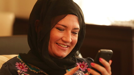 Muslim woman using smart phone