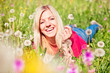 playful girl lying in a - meadow 03
