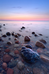 Amazing stones in the ocean. The Baltic Sea coast, Poland.