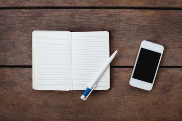 smartphone and notepad on the desk