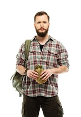 Handsome traveler with backpack and flask isolated on white