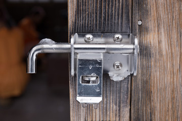 The padlock locking the wooden door
