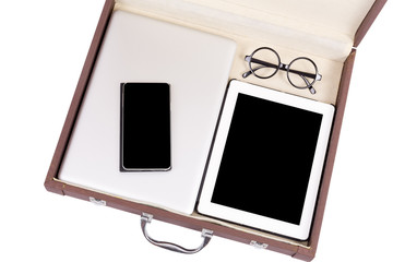 blank tablet, mobile and electronic devices in briefcase