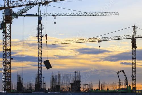 crane of building construction against beautiful dusky sky - 65316683