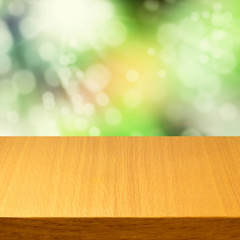 Empty wooden modern table over green bokeh background