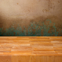 Background with wooden board over grunge concrete wall