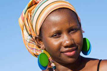 Attractive African woman listening carefully.