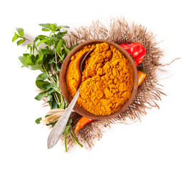 Curry spice in bowl isolated on white