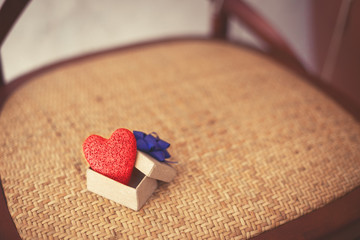 handmade red heart in gift box and vintage chair