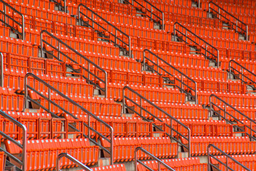 stadium, red seats on stadium steps bleacher