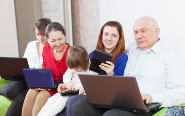 Happy family of with portable computers