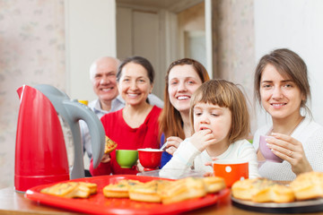 family posing over tea at home