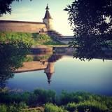 Pskov Kremlin reflection in Pskova river. Russia.  poster