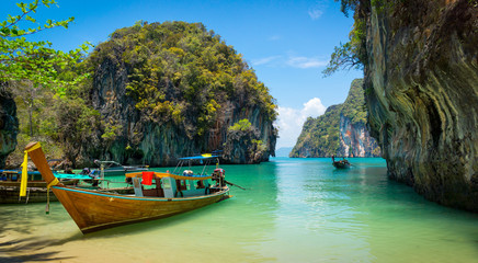 Traditional longtail boats near tropical island