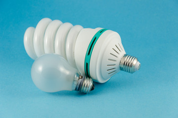 economy lamp incandescent bulb on blue background