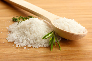 salt in spoon with fresh  rosemary and thyme