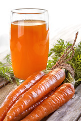 healthy juice made from organic carrots from the garden