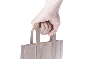 Brown paper shopping bag isolated on white background