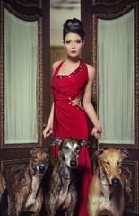 beautiful woman with greyhounds