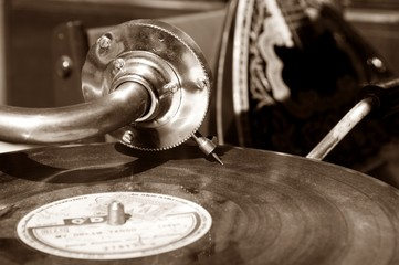 Vintage gramophone with a vinyl. Sepia