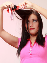 Childish woman infantile girl combing hair