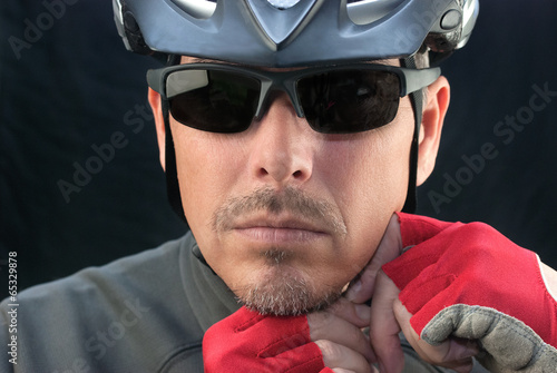Bicycle Courier Puts On Helmet
