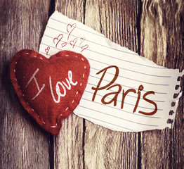 I Love Paris written on a peace of paper and a heart