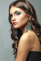 brunette girl with long hair and creative makeup