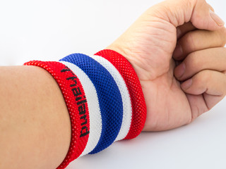 the wristband have colourful on wrist human for cheer