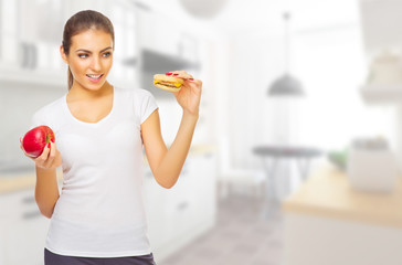 Girl with apple and hamburger