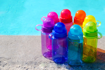 Color water bottles  by the pool