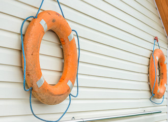 life buoy with rope hanging around the pool