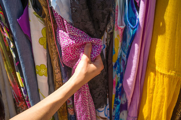 Female hands choosing clothes