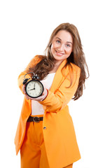 A  nice smiling girl holds in hands alarm clock