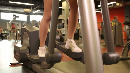 Young girl exercising at the Gym