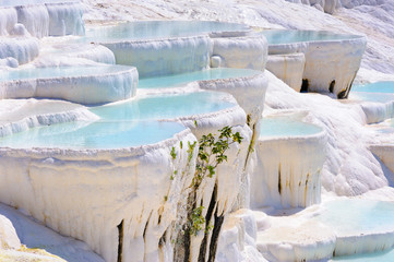 Blue cyan water travertine pools at Pamukkale, Turkey