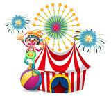 A clown near the circus tent poster