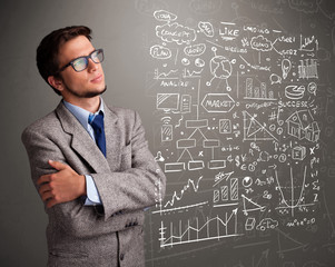 Attractive man looking at stock market graphs and symbols
