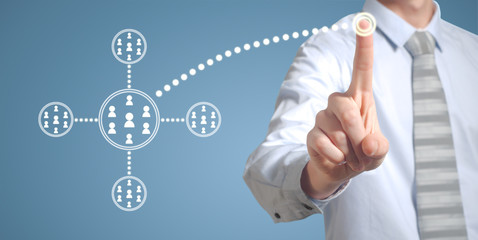 Businessman pressing technology network button