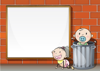 Babies near the wall with an empty signboard