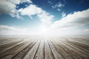 wooden surface under blue sky