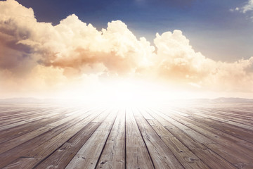 wooden surface under vintage sky
