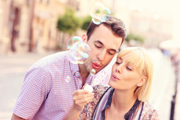 Young couple and bubbles