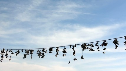 Shoes hang on a rope